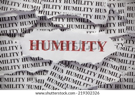 "Torn pieces of paper with words ""Humility"""