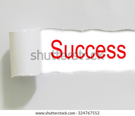 Torn white paper with word success on white background - stock photo