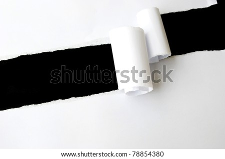 torn white sheet of paper with black background and copyspace - stock photo