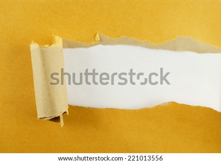 Torn yellow paper with pink background  - stock photo