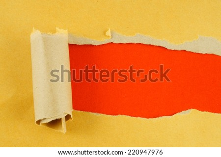 Torn yellow paper with red background  - stock photo