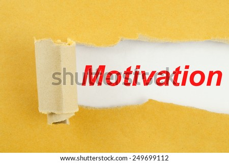 Torn yellow paper with word motivation on white background  - stock photo