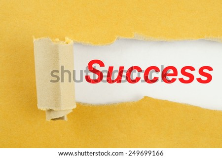 Torn yellow paper with word success on white background  - stock photo