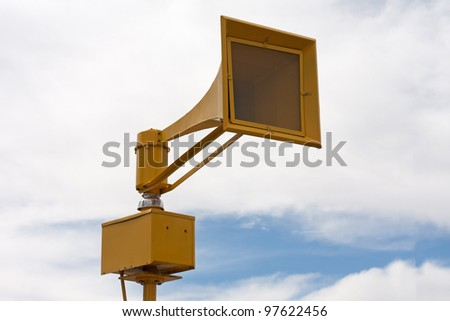 Tornado air raid tsunami siren on pole - stock photo