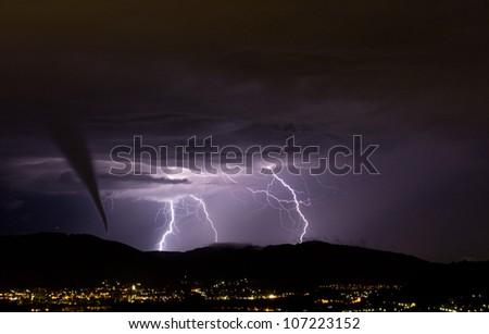 tornado and lightening strike - stock photo