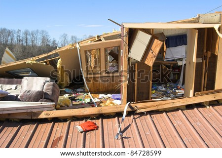 Tornado ripped through area destroying 1000 of homes & business,