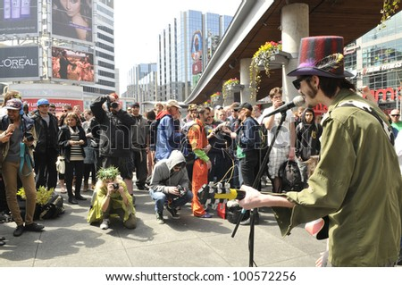 TORONTO - APRIL 20:  Live band performing and entertaining crows during the annual marijuana 420 event at Yonge & Dundas Square  on April 20  2012 in Toronto, Canada. - stock photo