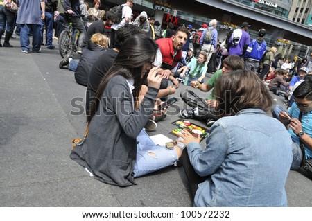 TORONTO - APRIL 20:  Marijuana smokers smoking pot during the annual marijuana 420 event at Yonge & Dundas Square  on April 20  2012 in Toronto, Canada. - stock photo