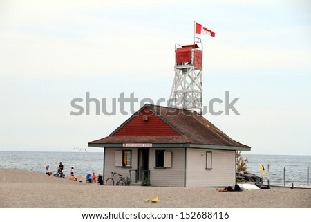 TORONTO - AUGUST 25: A view of the beach on the Lake Ontario on August 25, 2013 in Toronto. Lake Ontario is the easternmost of the Great Lakes and the smallest in surface area (7,340 sq mi, 18,960km2) - stock photo