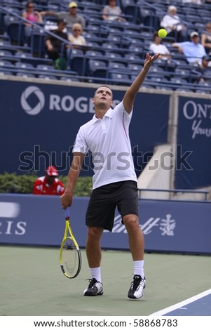 TORONTO: AUGUST 09. Mikhail Youzhny plays against Gilles Simon in the Rogers Cup 2010 on August 09, 2010 in Toronto, Canada.