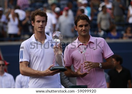 TORONTO: AUGUST 15.Roger Federer and Andy Murray greet fans after their tournament in the Rogers Cup 2010 finals on August 15, 2010 in Toronto, Canada. - stock photo