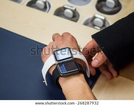 TORONTO, CANADA - APRIL 10, 2015: Customer tries out the new Apple Watch at the retail store. Apple begins the Apple Watch pre-order in Canada this day. - stock photo