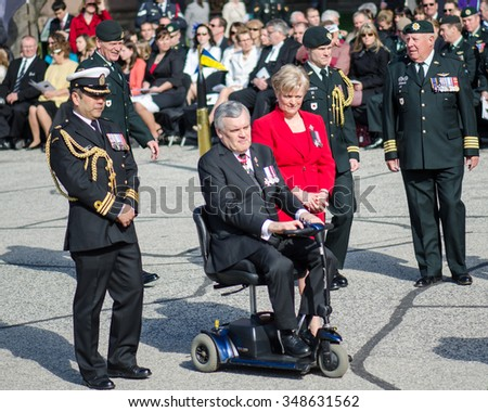 TORONTO,CANADA-APRIL 21,2013:David Onley (scooter), Liutenant Governor of the Province of Ontario and Canadian Armed Forces (CAF) commemorate the 200th anniversary of the Battle of York