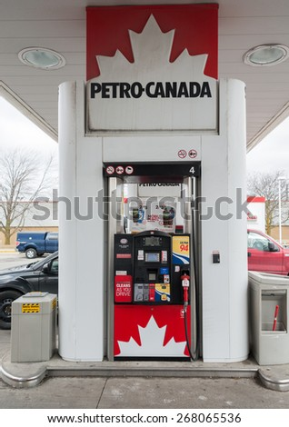 TORONTO,CANADA-APRIL 4,2015: Petro Canada gasoline pump. Petro-Canada is a retail and wholesale marketing brand of Suncor Energy. Until 2009, it was a crown corporation headquartered in Calgary. - stock photo