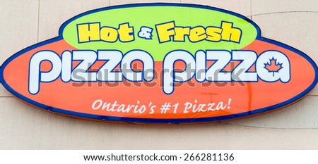 TORONTO,CANADA-APRIL 2,2015: Pizza Pizza Limited is a franchised Canadian pizza fast-food restaurant. Its restaurants are mainly located in the province of Ontario. - stock photo