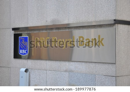 Toronto, Canada - April 27, 2014:  Sign of the Royal Bank of Canada's building located in the Financial District of Toronto. RBC is one of the major and leading banking institutions of Canada. - stock photo