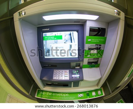 TORONTO,CANADA-APRIL 4,2015: TD bank ATM, discard the envelope policy.The Toronto-Dominion Bank is a Canadian multinational banking and financial services corporation headquartered in Toronto. - stock photo