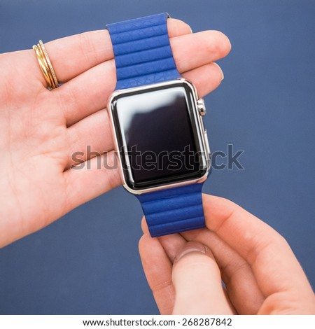 TORONTO, CANADA - APRIL 10, 2015: The staff holds a new Apple Watch at the retail store in Toronto. Apple begins the Apple watch pre-order at the Canadian retail stores this day. - stock photo