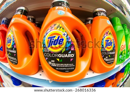TORONTO,CANADA-APRIL 4,2015: Tide laundry detergent in store shelf.Tide is the brand-name of a laundry detergent manufactured by Procter & Gamble, first introduced in 1946 - stock photo