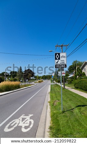 TORONTO, CANADA - 19 AUGUST 2014: A cycle Lane in Toronto showing a sign and road markings