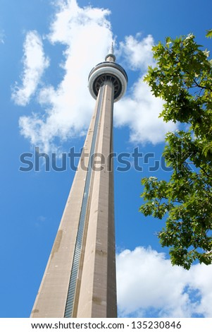 TORONTO, CANADA - AUGUST 1: CN Tower on August 1, 2008 in Toronto, Canada. It is one of the symbols of Canada with its 553.33 metres (1,815.4 ft) height. - stock photo