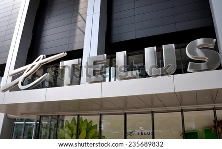 Toronto, Canada - August 3,, 2014: Signage of Telus company in front of building. - stock photo