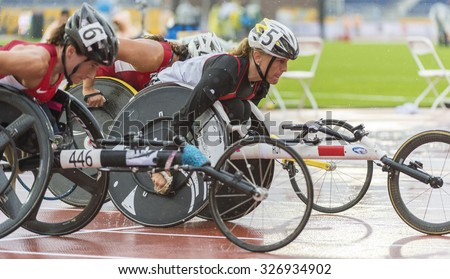 TORONTO,CANADA-AUGUST 8,2015:Wheelchair racing athletes competing at the 2015 Parapan American Games. Case # 01953074