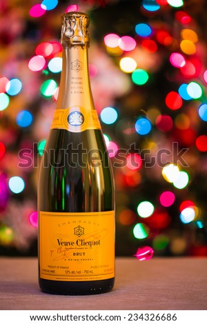 """TORONTO, CANADA - DECEMBER 29, 2013: A bottle of """"Veuve Clicquot"""" fine champagne with blurred Christmas lights on a background. An illustration for winter holidays spirit. - stock photo"""