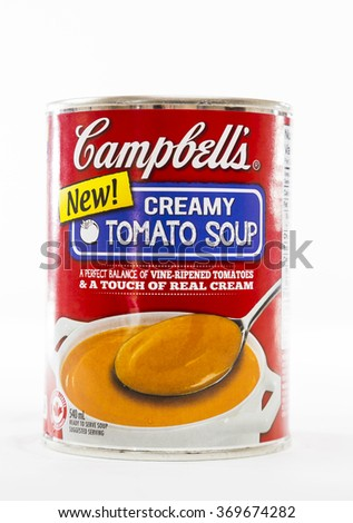 TORONTO, CANADA - DECEMBER 29, 2015 : Campbell's Brand of Creamy Tomato Soup in a Can Illustrative Editorial on Bright Background - stock photo