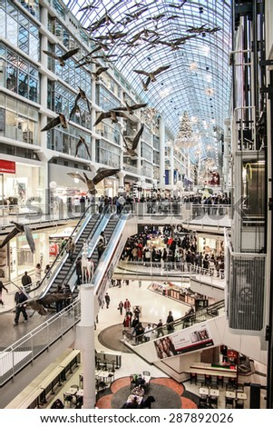 Toronto, Canada - 26 December, 2007 - Eaton Center shopping mall full of people in a boxing day.