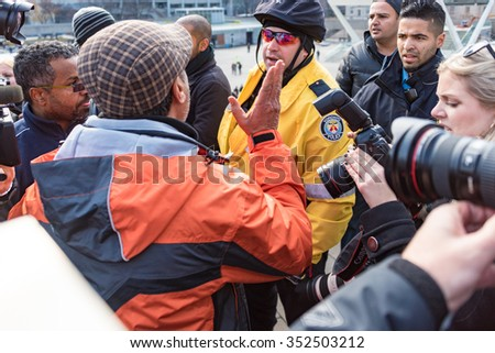 TORONTO,CANADA-DECEMBER 9,2015: Incidents involving Toronto Police during taxi drivers protest againt the unfair operation of UberX in the city and the lack of regulation by the Municiapal Government - stock photo