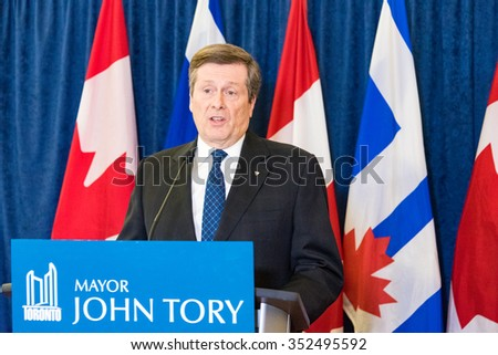 TORONTO,CANADA-DECEMBER 9,2015: Mayor John Tory in a press statement during the Toronto taxi drivers protest against UberX and the city lack of bylaw enforcement that allow unfair competition - stock photo