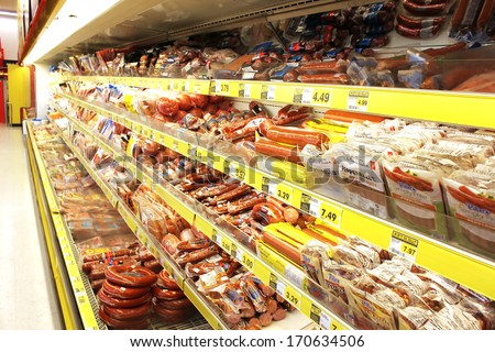 TORONTO, CANADA - DECEMBER 18, 2013: Processed meat products in a grocery store. North America is one of the leading consumers of processed meats in the world. - stock photo