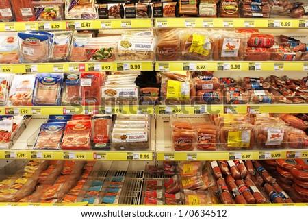 TORONTO, CANADA - DECEMBER 18, 2013: Processed meat products in a grocery store.North America is one of the leading consumers of processed meats in the world. - stock photo