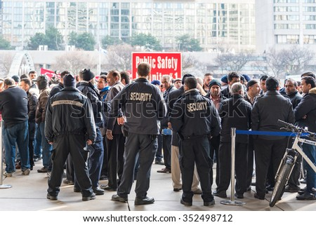 TORONTO,CANADA-DECEMBER 9,2015: Taxi drivers protest againt the operation of UberX and the lack or regulation that causes an unfair competition. View from inside the Toronto City Hall - stock photo