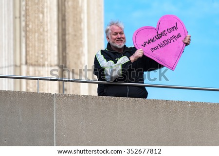 TORONTO,CANADA-DECEMBER 9,2015: Uber supporter provoking the taxi protesters against Uber outside city hall. This later provoked and incident between the parties which involved police. - stock photo