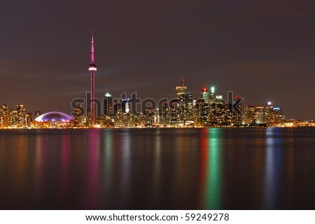 Toronto Canada Downtown from the island at night with refelctions into the lake.