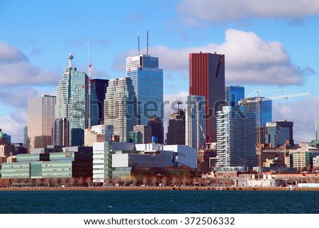TORONTO, CANADA - FEBRUARY 1, 2016: A view of the skyline of Downtown Toronto as seen from the industrial harbor.  - stock photo