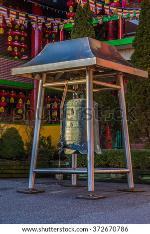 TORONTO, CANADA - February 01, 2016: Bell in Cham Shan Temple  Cham Shan is the oldest Chinese Buddhist temple in Toronto. Chinese New Year, worshipers lined up to make offerings and light incense.   - stock photo