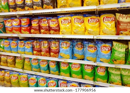 TORONTO, CANADA - FEBRUARY 11, 2014: Potato chips selection in a supermarket in Toronto, Canada. - stock photo