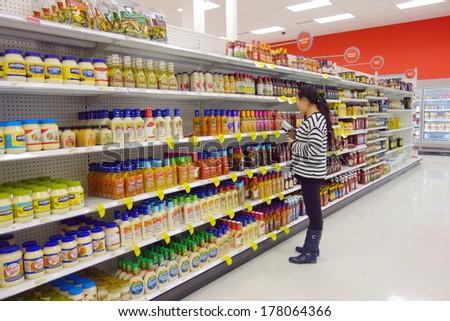 TORONTO, CANADA - FEBRUARY 11, 2014: Salad dressings selection in a supermarket shelf in Toronto, Canada. - stock photo