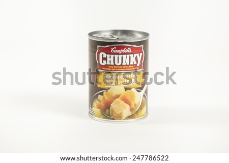 Toronto, Canada - January 27 2015 : A Can of Campbell's Chunky Chicken and Vegetable Soup of the ready to heat variety shown on a bright background - stock photo