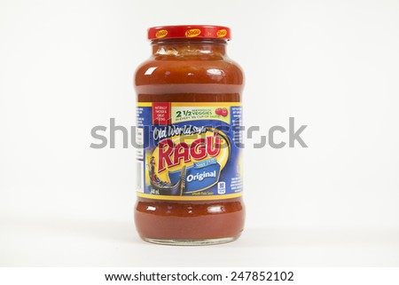Toronto, Canada - January 27 2015 : Glass Jar of Ragu Brand Tomato Pasta Sauce of the Original Recipe shown on a bright background - stock photo