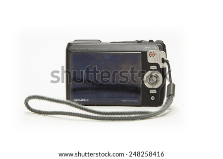 TORONTO, CANADA - JANUARY 28, 2015 : Olympus Tough Camera shown on a bright background, an original producer of consumer point and shoot waterproof cameras - stock photo
