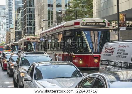 TORONTO, CANADA - JULY 23, 2014: City transportation streetcar. Toronto streetcar system comprises eleven streetcar routes in Toronto, operated by Toronto Transit Commission (TTC). - stock photo