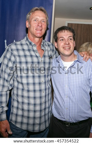 TORONTO, CANADA - JULY 9, 2016: Former Toronto Blue Jay Third Baseman Kelly Gruber with fan at Toronto Baseball Legends event.