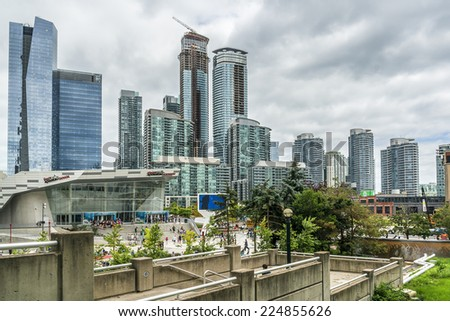 TORONTO, CANADA - JULY 23, 2014: Modern Architecture in Downtown Toronto. Downtown Toronto has prominent buildings in a variety of styles by many famous architects. - stock photo