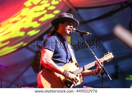 TORONTO, CANADA - JULY 1, 2016: Musician Michael Franti performs at TD Jazz Festival in Toronto.