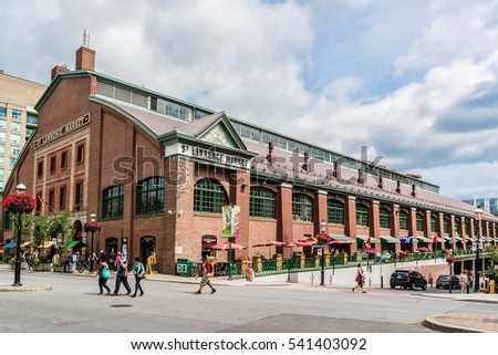 TORONTO, CANADA - 23 JULY, 2014: Red brick building in Downtown Toronto. Downtown Toronto has prominent buildings in a variety of styles by many famous architects.