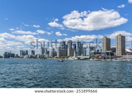 TORONTO, CANADA - JULY 23, 2014: The beautiful Toronto's skyline over Lake Ontario. Urban architecture.  - stock photo